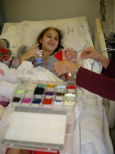 "I received ""Beads of Courage"" for every procedure, poke, day of chemo, ect.  This is me collecting them during my second round of chemotherapy."