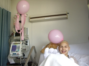 Me and Ricco (my IV pump) get decorated for my last hospital chemo party!